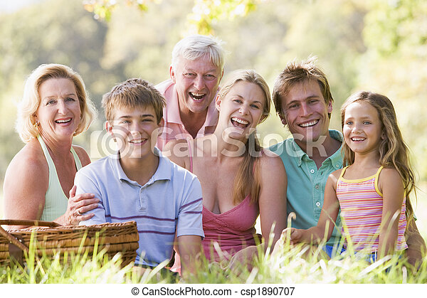 Family at a picnic smiling - csp1890707