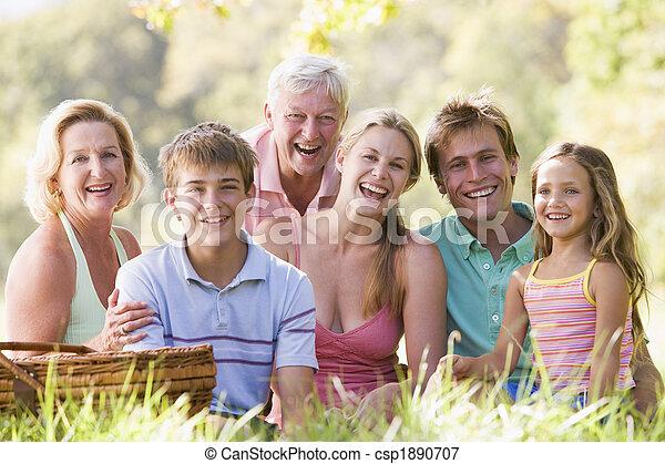 Family at a picnic smiling - csp1890707
