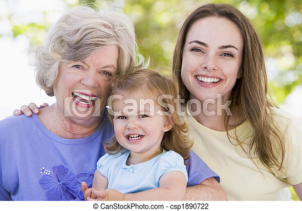 Grandmother with adult daughter and grandchild in park - csp1890722