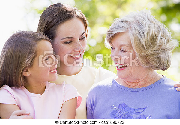 Grandmother with adult daughter and grandchild in park - csp1890723