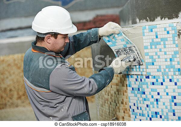tilers at industrial floor tiling renovation - csp18916038