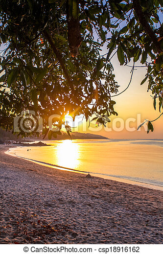 Beautiful sunrise over the tropical beach - csp18916162