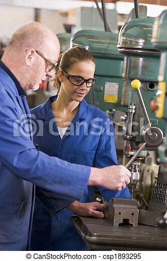 Two machinists working on machine - csp1893295