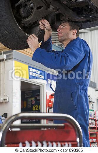 Mechanic working under car - csp1893365