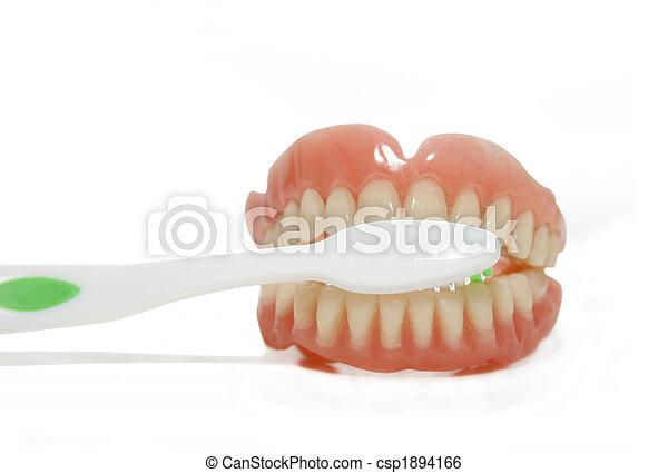 false teeth and toothbrush - csp1894166