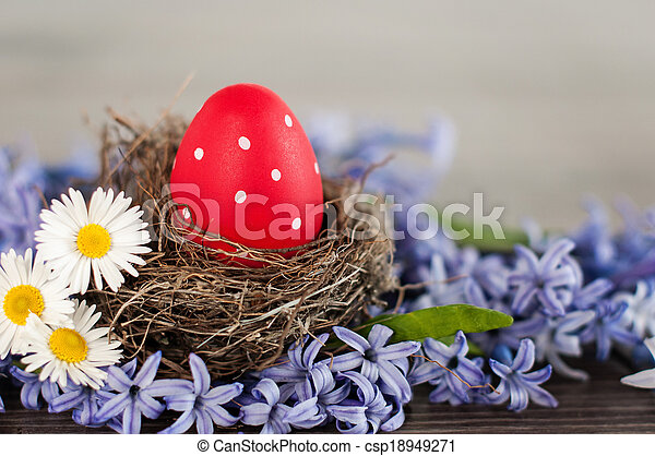 Red Easter egg in a nest - csp18949271