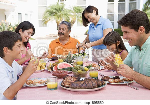 Family Enjoying A Barbeque - csp1895550