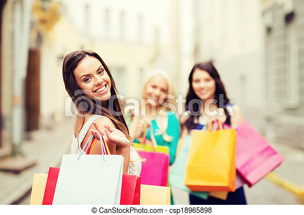 girls with shopping bags in city - csp18965898