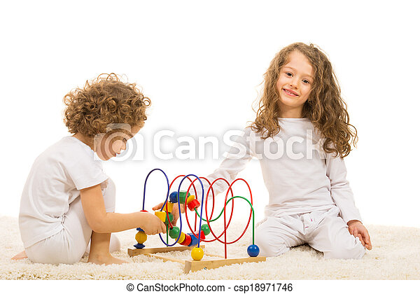 Sisters playing with wooden toy home - csp18971746