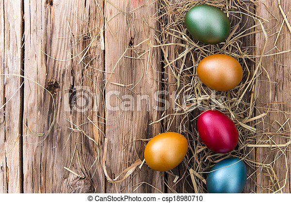 Easter eggs on wooden background - csp18980710