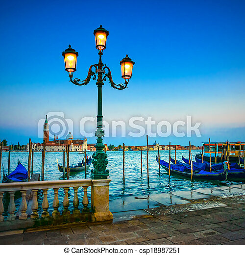 Venice, street lamp and gondolas or gondole on a blue sunset twilight and San Giorgio Maggiore church landmark on background. Italy, Europe. - csp18987251