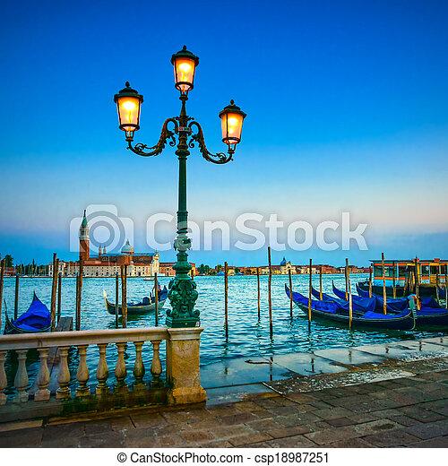Venice, street lamp and gondolas or gondole on a blue sunset twilight and San Giorgio Maggiore church landmark on background. Italy, Europe. - csp18987251