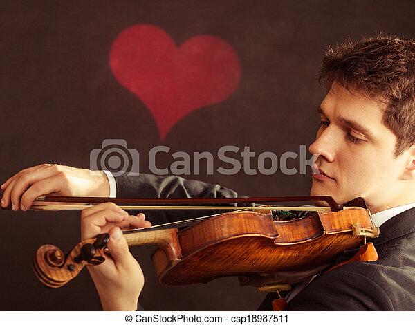 Man violinist playing violin. Classical music art - csp18987511