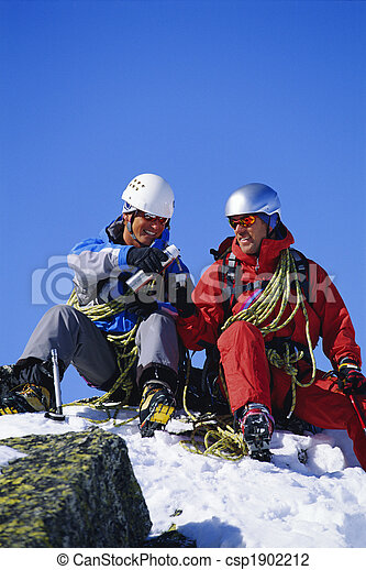 Young men mountain climbing on snowy peak - csp1902212