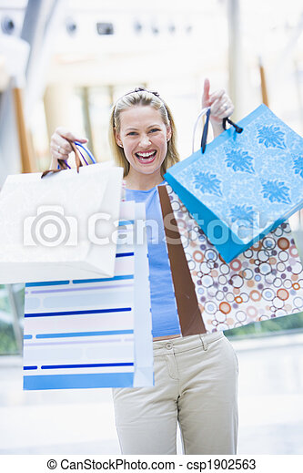 Woman shopping in mall - csp1902563