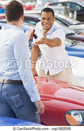 Man collecting new car from salesman - csp1902595
