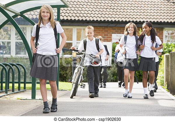 Junior school children leaving school - csp1902630