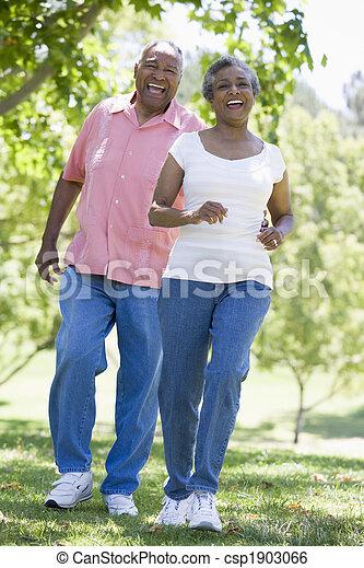 Senior couple having fun in park - csp1903066