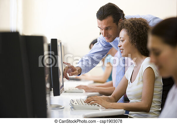 Man assisting woman in computer room - csp1903078