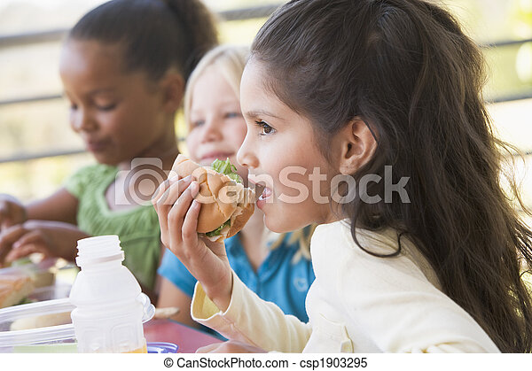 Kindergarten children eating lunch - csp1903295