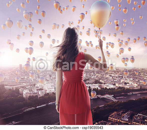 Young lady and the city of the balloons - csp19035543