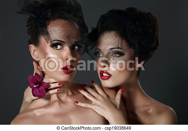 Fantasy. Pair of Desirable Gorgeous Women in Dark Veils. Togetherness - csp19038649