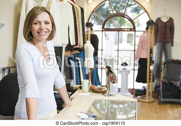 Woman at clothing store smiling - csp1904110