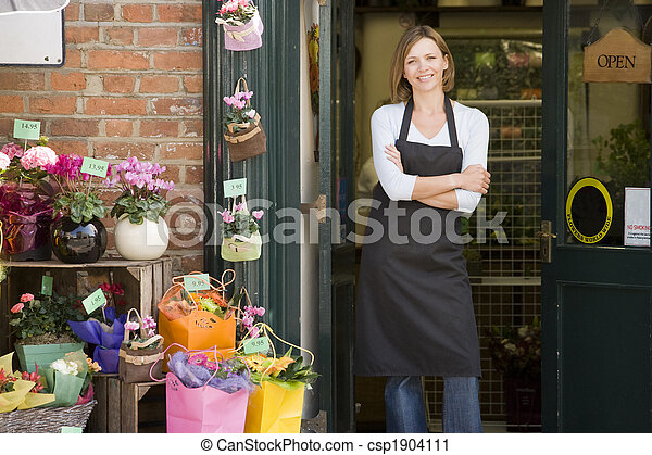 Woman working at flower shop smiling - csp1904111