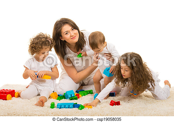 Beauty mom playing with her kids home - csp19058035