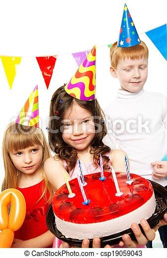Happy little children celebrating birthday with cake - csp19059043