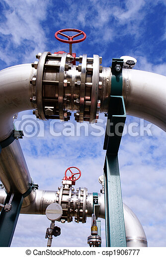 Pipes, bolts, valves against blue sky - csp1906777