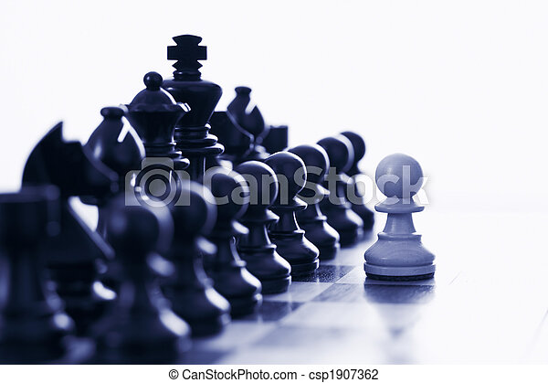 White pawn challenging black chess pieces - csp1907362