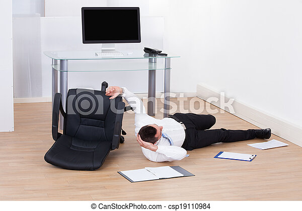 Businessman Fallen From Office Chair - csp19110984