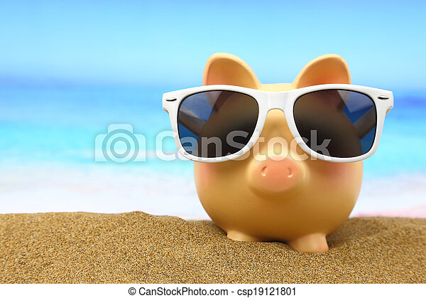 Summer piggy bank with sunglasses on the beach - csp19121801