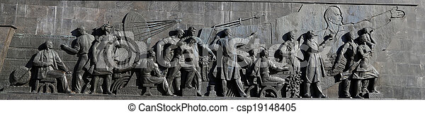 Detail from the titanium obelisk representing the Soviet succes dream, featuring scientists and engineers hard at work. Monument of Sovjet space flight, near VDNK exhibition center, Moscow, Russia - csp19148405