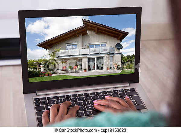 African American woman selecting new house on laptop at home - csp19153823
