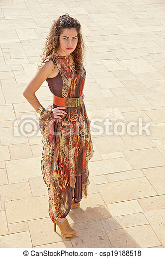 the girl in the new trendy, stylish dress or suit posing for a photograph for advertising - csp19188518