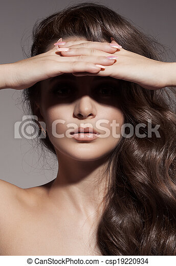 Fashion Portrait. Beautiful Brunette Girl. Curly Hair. - csp19220934