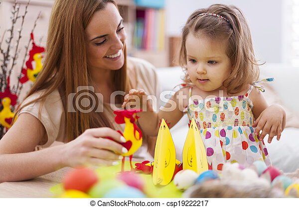 Young mother playing with her baby in easter time - csp19222217