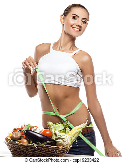 Happy young woman holding basket with vegetable. Concept vegetarian dieting - healthy food - csp19233422