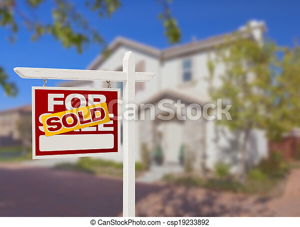 Sold Home For Sale Sign in Front of New House - csp19233892