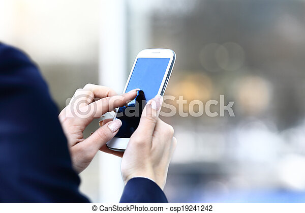 Close up of a business woman using mobile smart phone