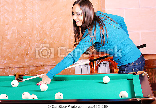 Woman in blue jumper playing billiards - csp1924269