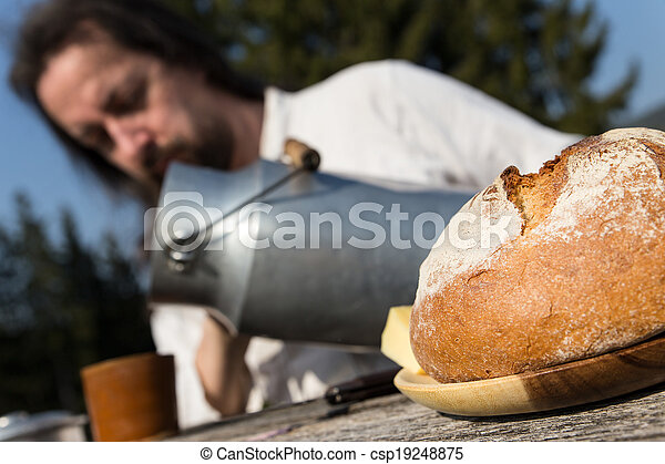 rural picnic with milk churn and bread - csp19248875
