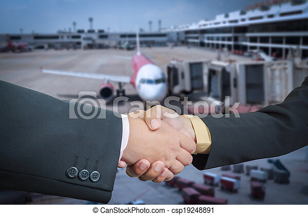 Businessman handshake with air plane transportation logistic background - csp19248891