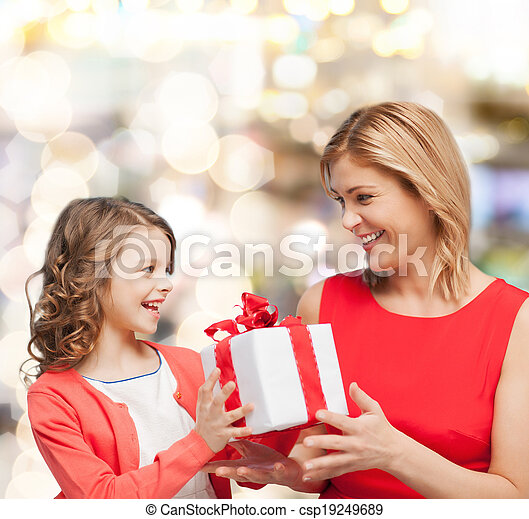 smiling mother and daughter with gift box - csp19249689