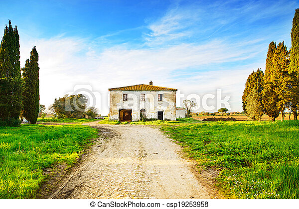 Old abandoned rural house, road and trees on sunset in spring.Tuscany, Italy - csp19253958