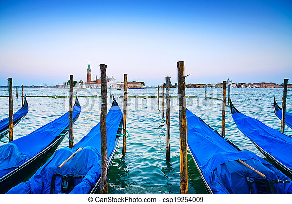 Venice, gondolas or gondole on a blue sunset twilight and San Giorgio Maggiore church landmark on background. Italy, Europe. - csp19254009