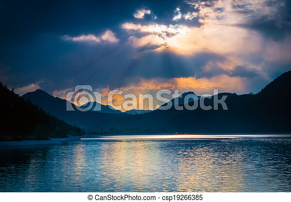 mystic mood at austrian lake with clouds where sunbeams shine through - csp19266385