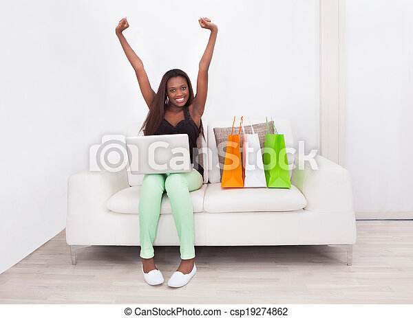 Excited Woman Shopping Online At Home - csp19274862